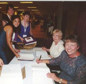 Linda Ablard, Executive Director, with Virginia Stafford signing Sisters.
